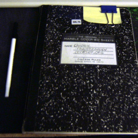 Photo of a closed composition notebook